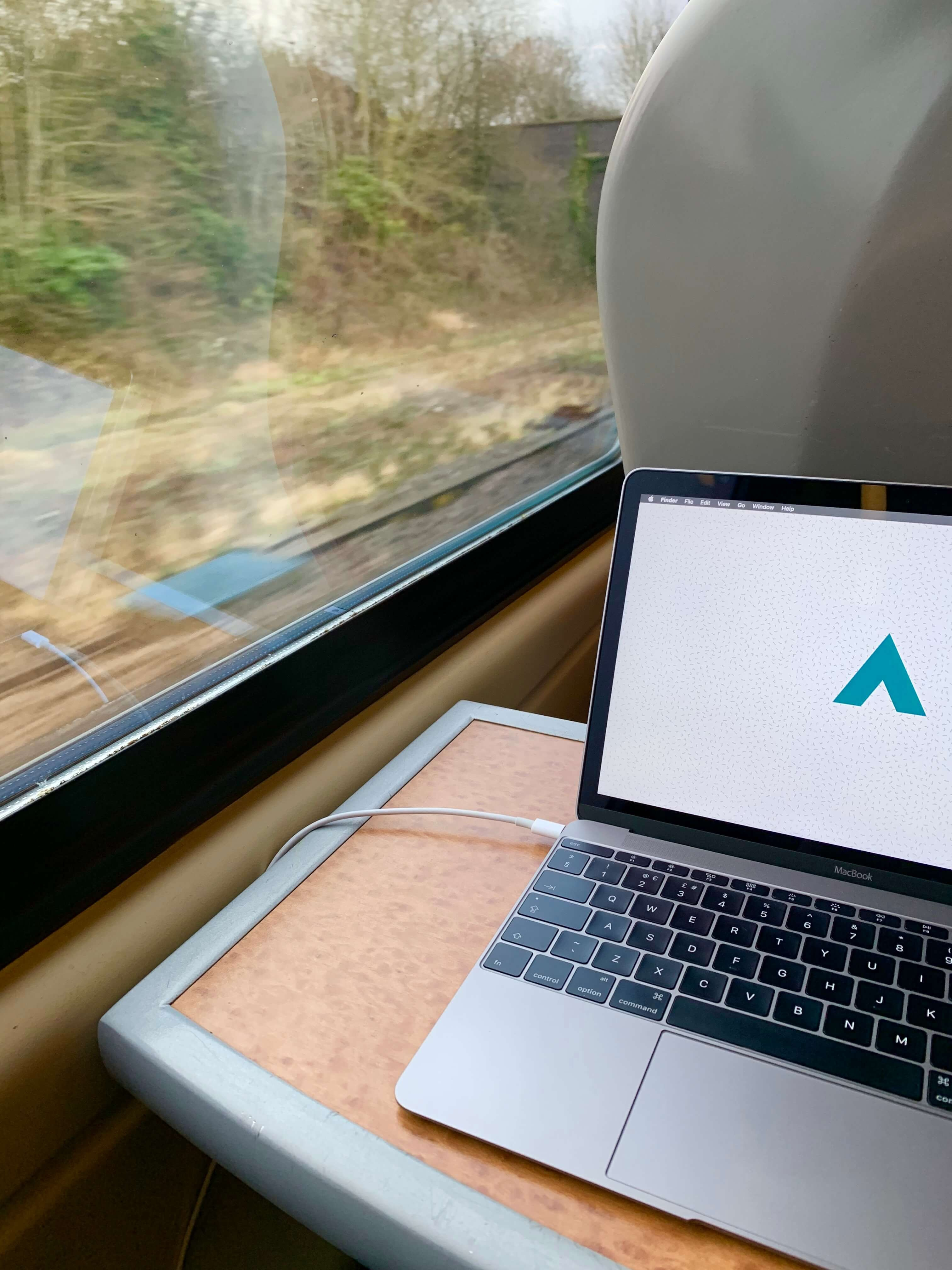 A laptop on a table inside a train